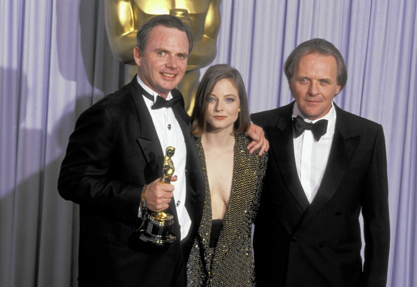 "Michael Blake won a 1991 screenwriting Oscar for Kevin Costner's film ""Dances With Wolves,"" which became the first western to win a best picture Academy Award since ""Cimarron"" in 1931. Above, Blake with presenters Jodie Foster and Anthony Hopkins."