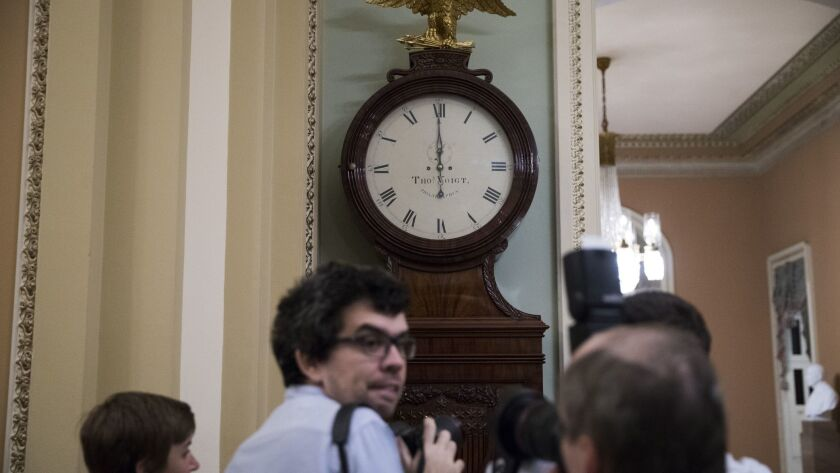 The clock strikes midnight in the U.S. Capitol.