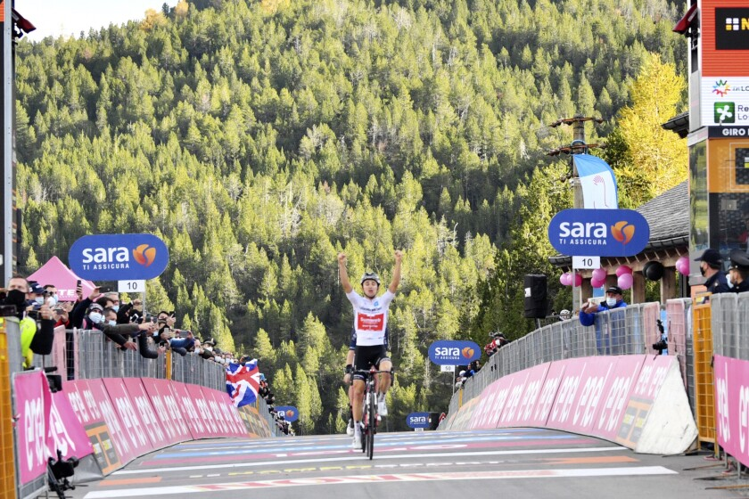 Australia's Jai Hindley celebrates winning the 18th stage of the Giro d'Italia cycling race from Pinzolo to Laghi di Cancano, northern Italy, Thursday, Oct. 22, 2020. (Massimo Paolone/LaPresse via AP)