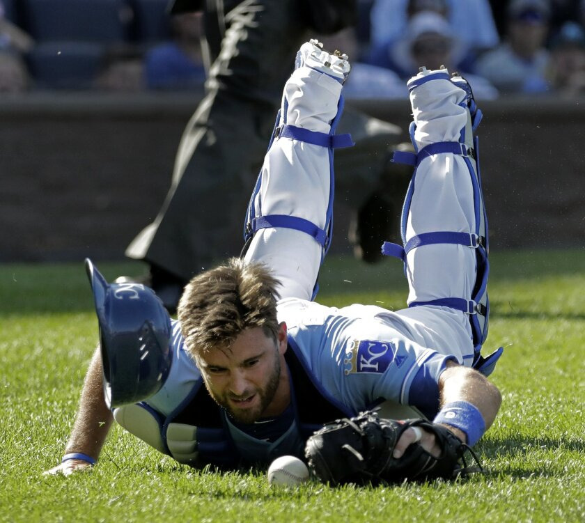 Kansas City Royals catcher Drew Butera dives for but misses a foul ball hit by Detroit Tigers' Jose Iglesias during the ninth inning of a baseball game, Sunday, Sept. 4, 2016, in Kansas City, Mo. The Tigers won 6-5. (AP Photo/Charlie Riedel)