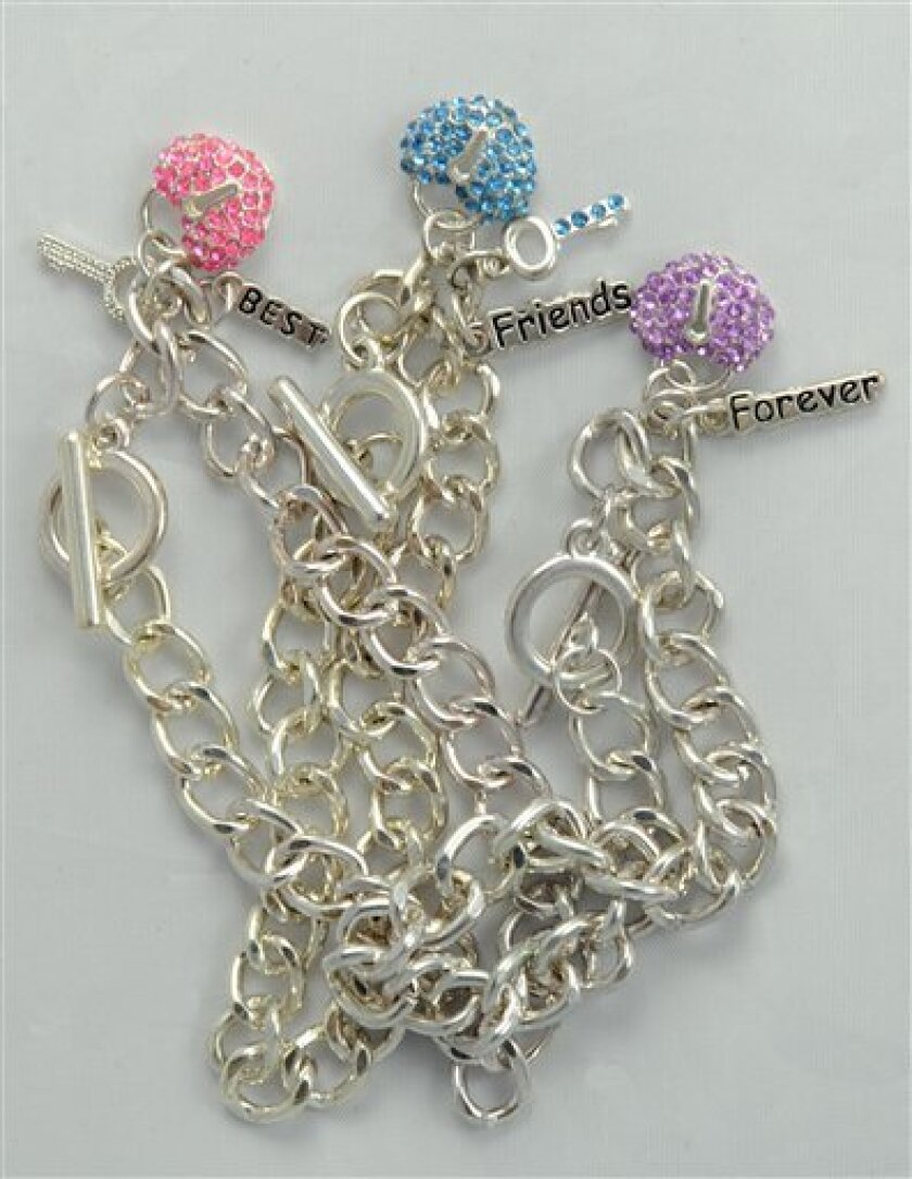 """FILE - This undated photo provided by the U.S. Consumer Product Safety Commission shows three sizes of """"Best Friends"""" charm bracelets, which were sold by Claire's Boutiques, which were recalled in 2010 because of high levels of cadmium., which can harm the kidneys and bones and is a known carcinogen. Major national retailers, including Target Corp. and Gap Inc., have agreed to all but eliminate the toxic metal cadmium in jewelry and other accessories they sell. (AP Photo/U.S. Consumer Product Safety Commission, File)"""