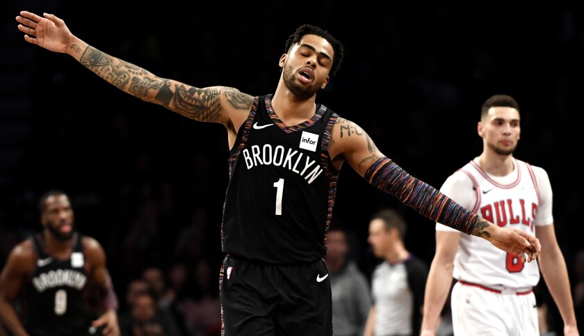 Nets point guard D'Angelo Russell reacts after a score against the Bulls during a game on Feb. 8.