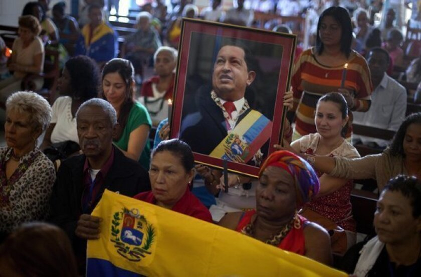 Venezuelan embassy workers in Havana, Cuba, pray for ailing President Hugo Chavez during the monthly Catholic service devoted to the sick at the Church of Our Lady in Regla.