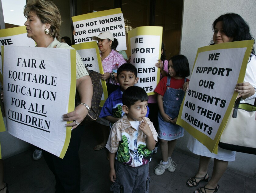 Protesters demonstrate outside an L.A. school board meeting over a proposal to require high school students to pass rigorous college-prep courses.
