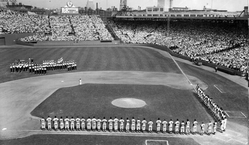 Players and coaches line up for the national anthem before the 1961 All-Star Game played at Fenway Park.