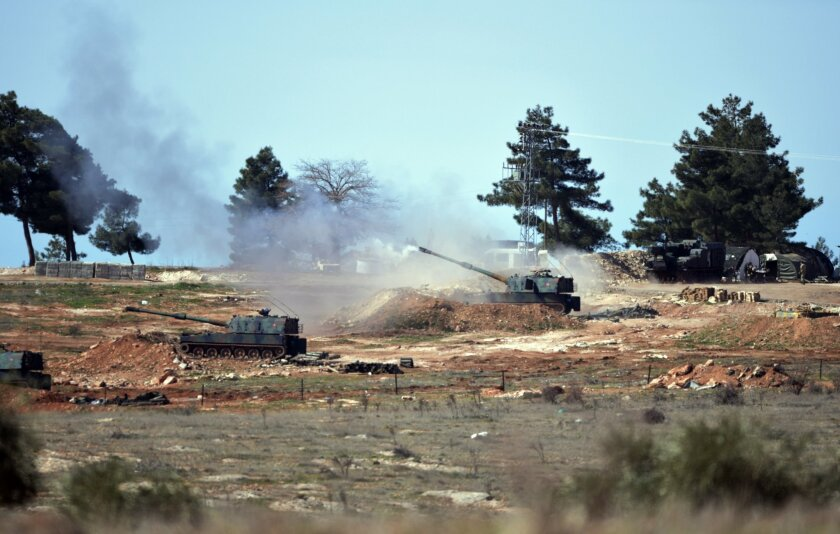 Turkish artillery fire from the border near Kilis town toward northern Syria, in Kilis, Turkey, Tuesday, Feb. 16, 2016. A Turkish official says his country is pushing the case for ground operations in Syria, hoping for the involvement of the U.S. and other allies in an international coalition again