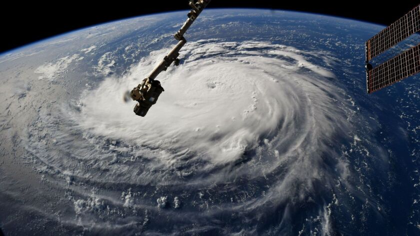 A photo made available by NASA shows Hurricane Florence over the Atlantic Ocean, as seen from the International Space Station.