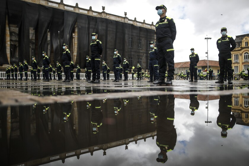 National Police attend a ceremony showing their new uniforms at Plaza de Bolivar in Bogota, Colombia, Monday, July 19, 2021. The uniforms changed from green to blue, and an arm patch features a QR code that allows anyone who scans it to see the officer's name, rank and badge number. (AP Photo/Ivan Valencia)