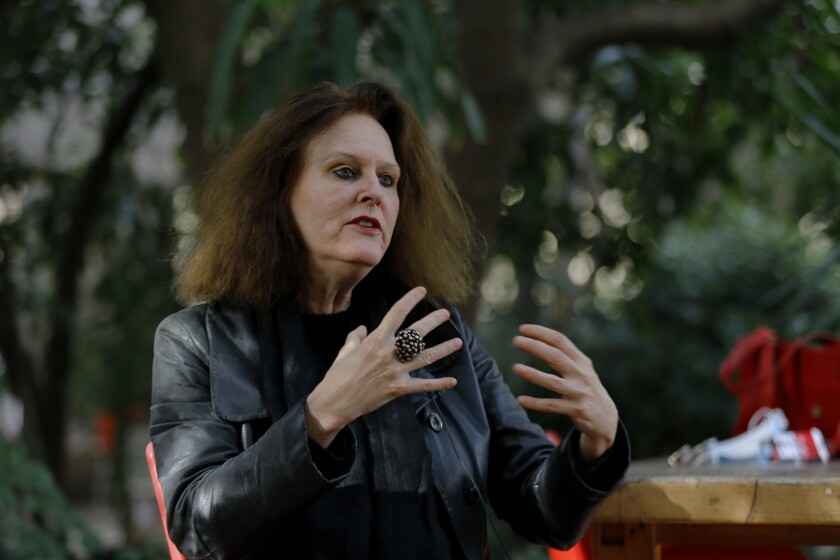 German Monika Borgmann, wife of Lokman Slim, a well-known Lebanese publisher and vocal critic of Hezbollah, the Lebanese Shiite Muslim political party, which has an armed wing of the same name, who was killed Thursday, speaks during an interview at her house in the southern Beirut suburb of Dahiyeh, Lebanon, Monday, Feb. 8, 2021. Borgmann said she is discussing with lawyers and friends how to push for an international investigation into her husband's murder. (AP Photo/Bilal Hussein)