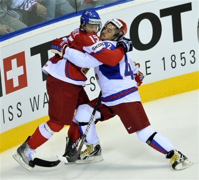 Jan Marek, left, of the Czech Republic confronts Sergei Zinovjev of Russian team during their qualification round group E Hockey World Championships match in Bratislava, Slovakia, Sunday, May 8, 2011. (AP Photo/CTK, Jan Koller) SLOVAKIA OUT