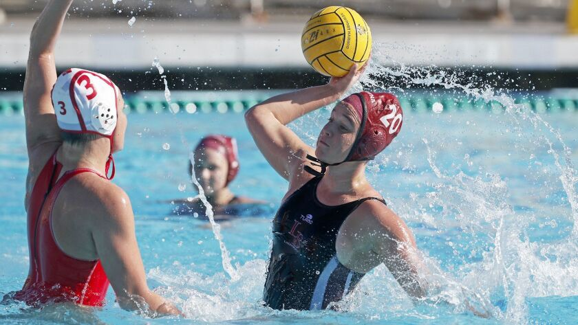 Laguna Beach High's Tea Poljak, right, competes against Orange Lutheran during the first half in the