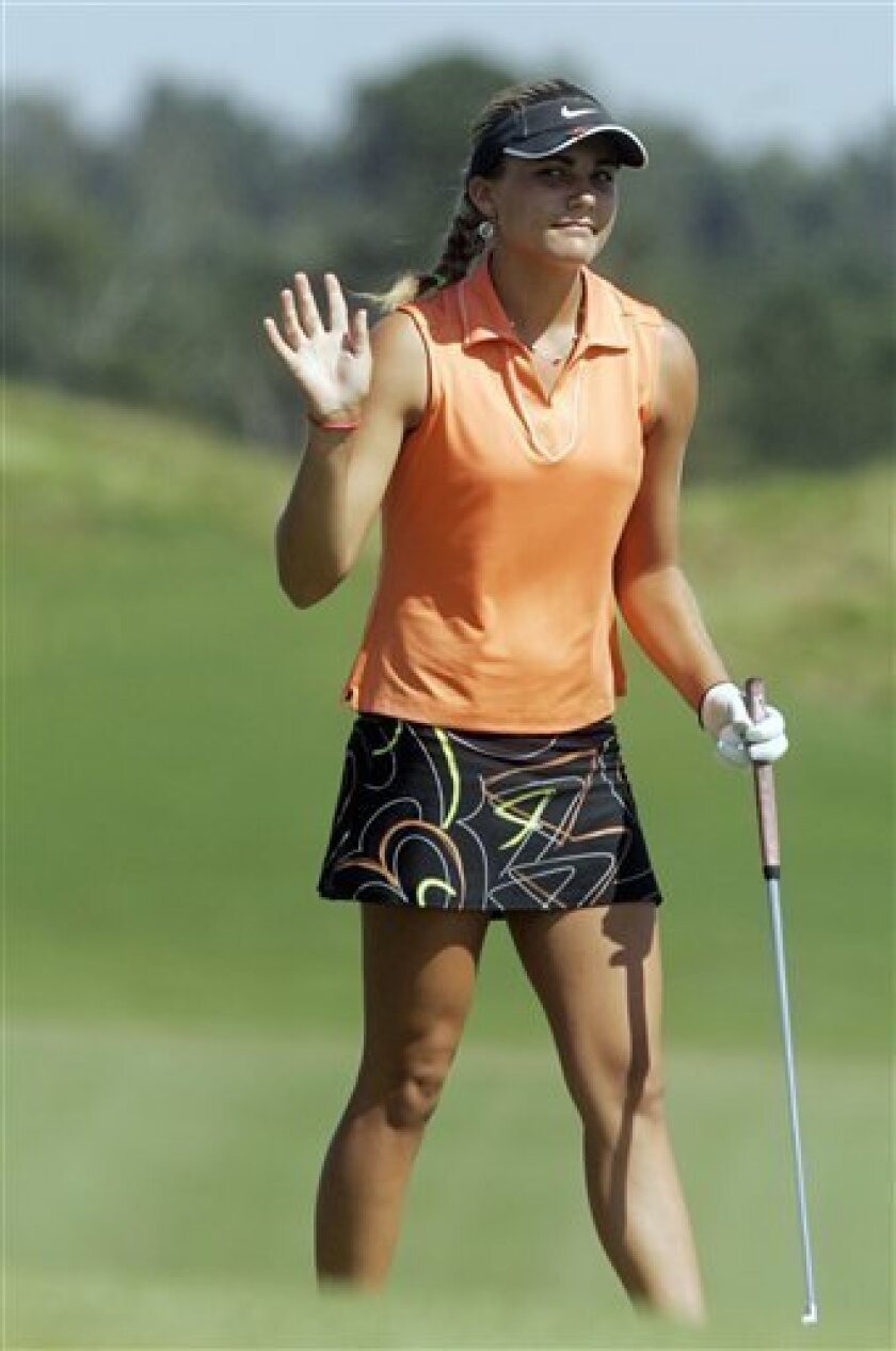 Alexis Thompson waves after completing her first round of the Navistar LPGA Classic golf tournament at the Robert Trent Jones Golf Trail at Capitol Hill on Thursday, Oct. 1, 2009 in Prattville, Ala. Thompson finished the round at 7-under-par. (AP Photo/Jamie Martin)