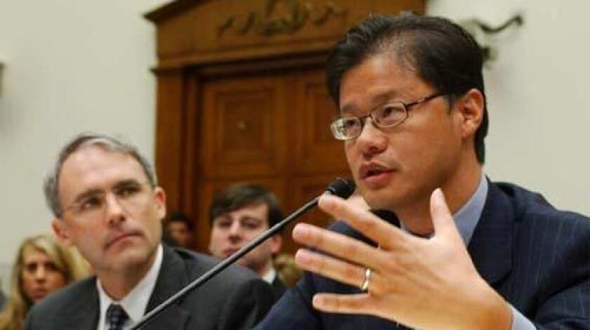 HUSH-HUSH: Yahoo is keeping details of the settlement with the Chinese families secret. Above, Yahoo CEO Jerry Yang, right, confers with counsel Michael Callahan on Capitol Hill on Nov. 6.