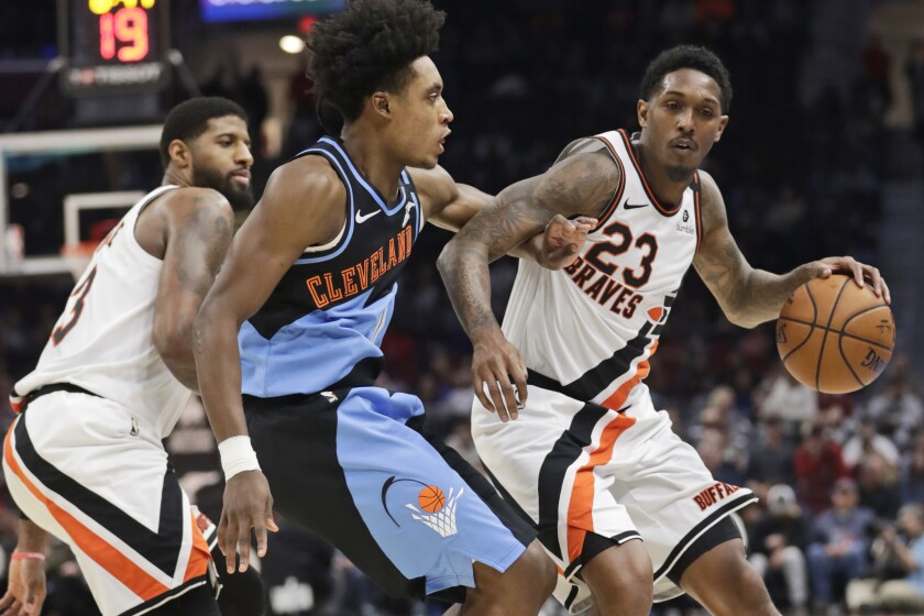 Los Angeles Clippers' Lou Williams (23) drives past Cleveland Cavaliers' Collin Sexton (2) in the second half of an NBA basketball game, Sunday, Feb. 9, 2020, in Cleveland. The Clippers won 133-92. (AP Photo/Tony Dejak)