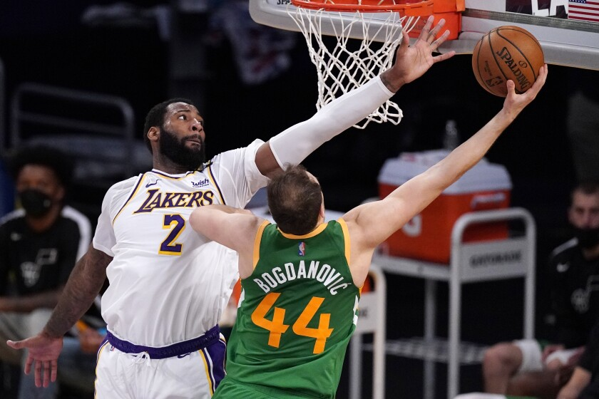 Lakers center Andre Drummond attempts to block a layup by Jazz forward Bojan Bogdanovic.