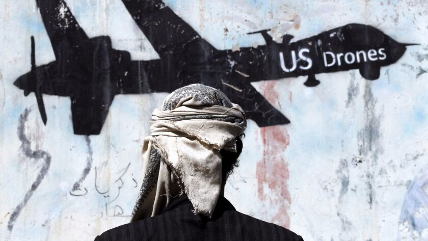 Graffiti in Sana, Yemen, protests U.S. military operations in the country.