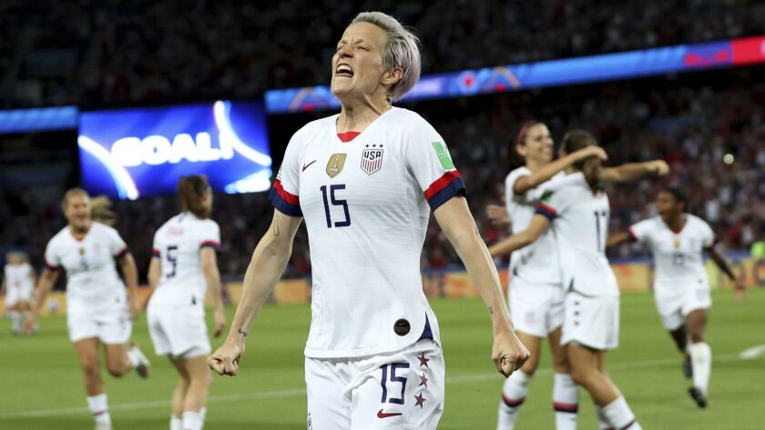 United States' Megan Rapinoe, center, celebrates after scoring her side's second goal during the Wom