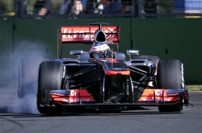 McLaren driver Jenson Button of Britain locks up the brakes as he enters turn three during the second practice session for Sunday's Australian Formula One Grand Prix at Albert Park in Melbourne, Australia, Friday, March 15, Friday, 2013. (AP Photo/Rob Griffith)