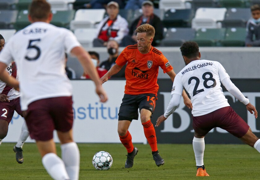Orange County Soccer Club midfielder Chris Wehan, center, plays against Sacramento Republic FC  on May 22.
