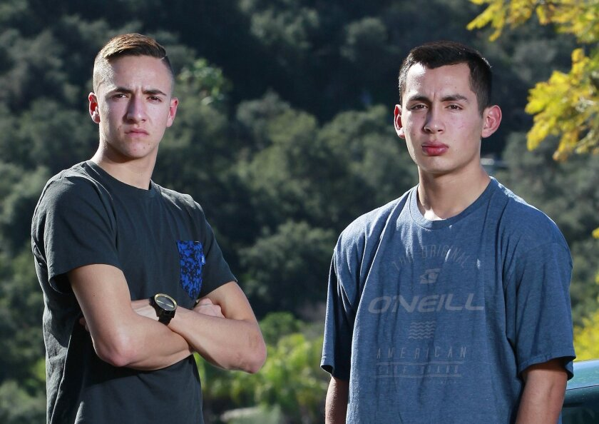 Brandon Cappelletti (left), 18, and Sam Serrato, 16, stand next to their cars on Tuesday.