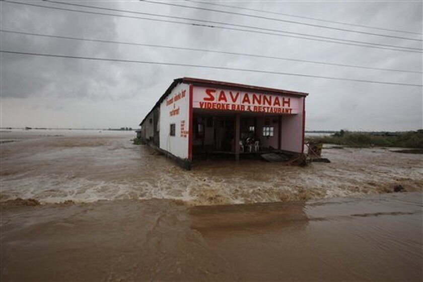 A bar and restaurant establishment is inundated by floodwaters as it lies isolated following massive flooding at Rosales township, Pangasinan province north of Manila, Philippines Friday Oct. 9, 2009. Rescuers struggled through mud and pounding rain Friday to clear mountain roads and retrieve the dead from dozens of landslides that buried villages and cut off towns in the rain-soaked northern Philippines. (AP Photo/Bullit Marquez)