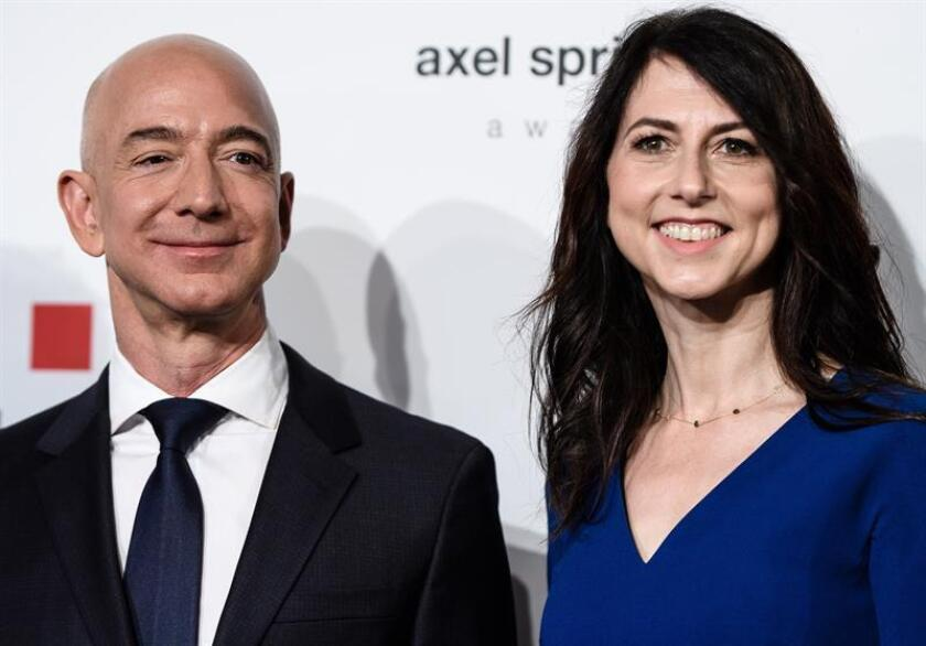 Stock photograph dated April 24, 2018 and released Jan. 9, 2019, showing Amazon CEO Jeff Bezos and his wife MacKenzie Bezos at the 2018 Axel Springer Prize in Berlin, Germany. Amazon CEO Jeff Bezos and his wife MacKenzie announced today in a joint statement that they are divorcing after 25 years of marriage. EPA-EFE/ Clemens Bilan/FILE