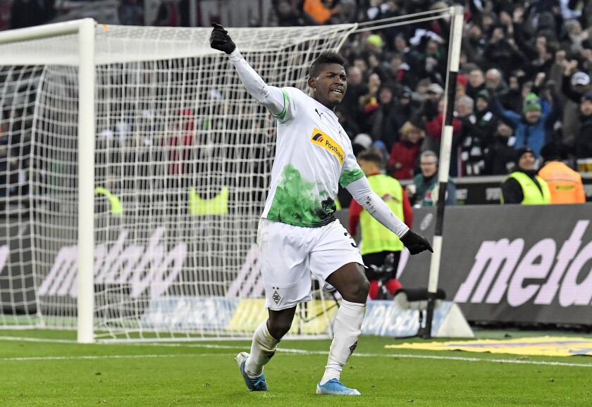 Moenchengladbach's Breel Embolo celebrates after their third goal by Hermann during the German Bundesliga soccer match between Borussia Moenchengladbach and SC Freiburg in Moenchengladbach, Germany, Sunday, Dec. 1, 2019. (AP Photo/Martin Meissner)