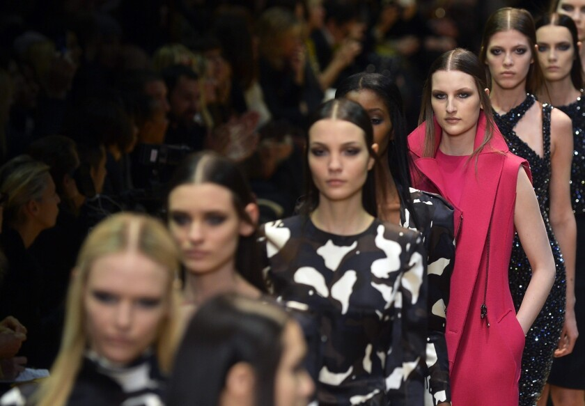 Models present creations by French fashion house Guy Laroche during Paris Fashion Week.