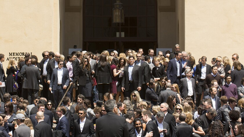 Mourners leave a memorial service for SurveyMonkey CEO David Goldberg at Stanford University.