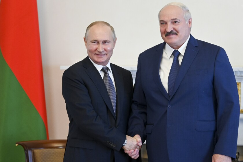 """Russian President Vladimir Putin, left, and Belarusian President Alexander Lukashenko pose for a photo during their meeting in St. Petersburg, Russia, Tuesday, July 13, 2021. Putin has hosted the leader of Belarus, who has increasingly relied on Moscow's support amid increasing tensions with the West. Belarus' authoritarian President Alexander Lukashenko thanked Putin for a """"very serious support from Russia"""" and pledged that his country will duly repay its loans. (Alexei Nikolsky, Sputnik, Kremlin Pool Photo via AP)"""