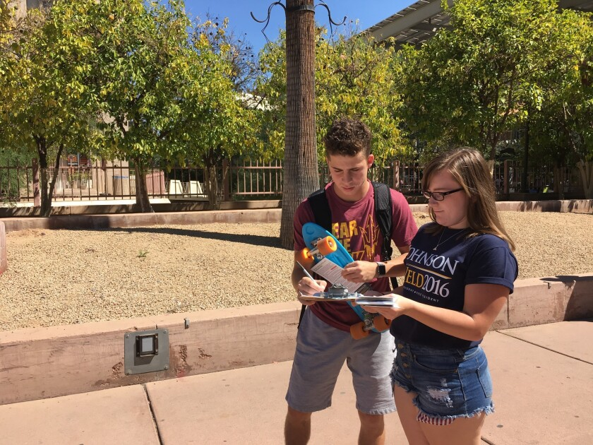 Lauren McCarthy signs up Arizona State University student Brett Amaral to the Johnson campaign mailing list.