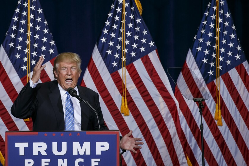 Donald Trump lays out his immigration policy at a rally in Phoenix.