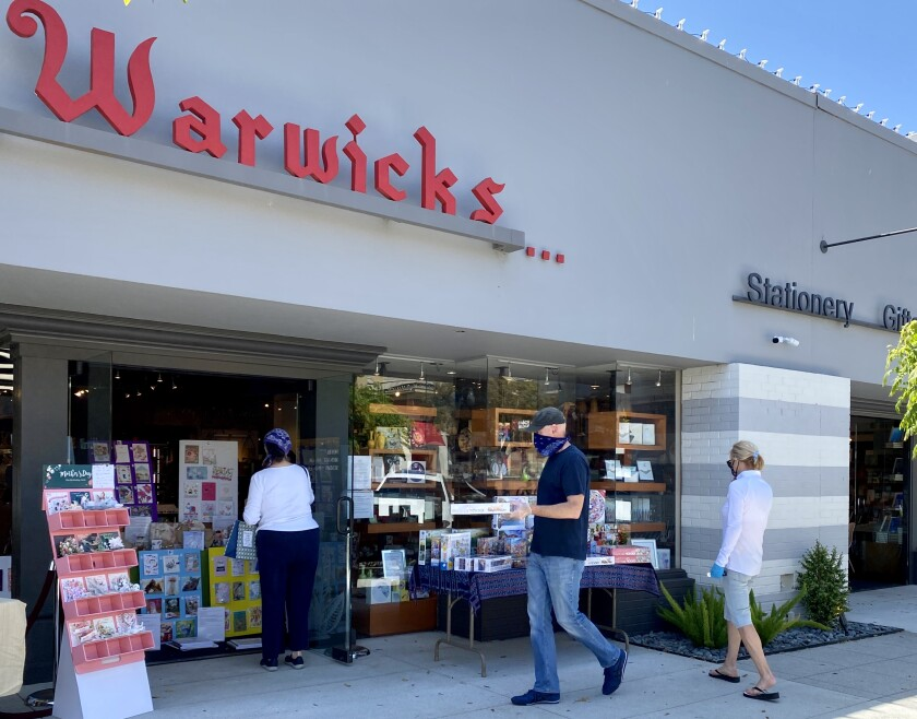 Warwick's on Girard Avenue, along with many other La Jolla businesses, is open for curbside shopping with mask and social distancing requirements.