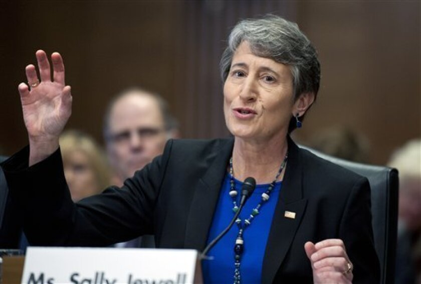 FILE - In this March 7, 2013, file photo, Interior Secretary nominee Sally Jewell testifies on Capitol Hill in Washington, before the Senate Energy and Natural Resources Committee hearing on her nomination. The Senate confirmed her on Wednesday, April 10. (AP Photo/Cliff Owen, File)