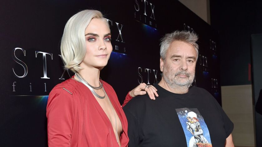 Cara Delevingne and director Luc Besson.