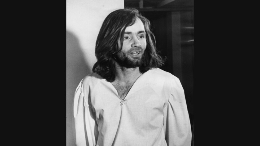 Charles Manson is led back to his cell after a court appearance in 1970.