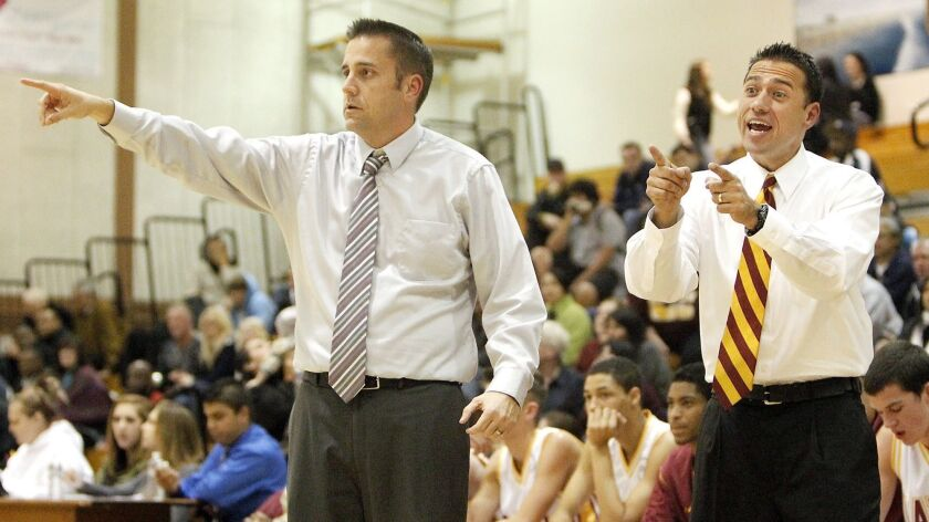 Jimmy Harris, right, shown coaching with Tim Walsh, left, on Dec. 6, 2011, is taking over again as coach of the Ocean View High boys' basketball program. He shared the coaching duties from 2002-12.