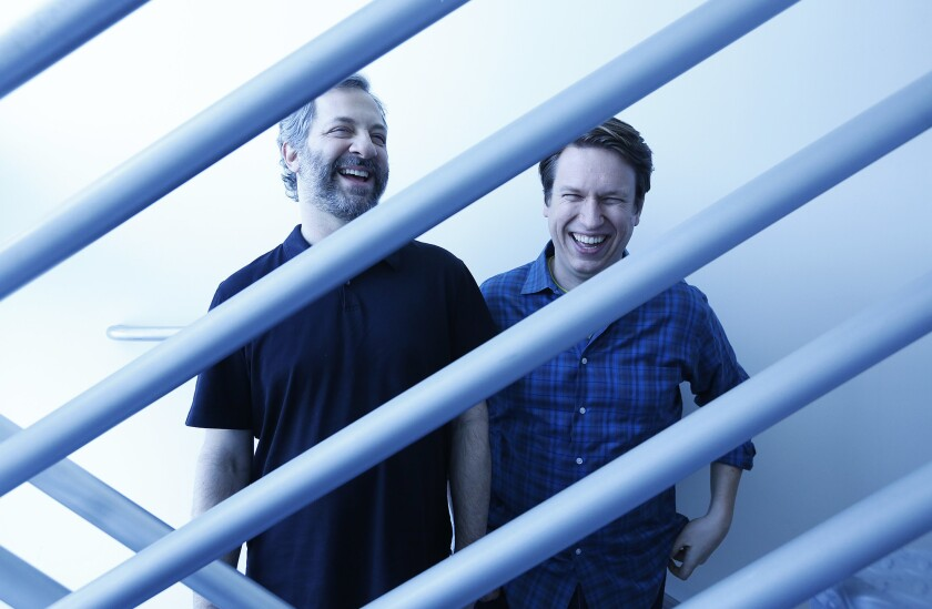 "Judd Apatow, left, and Pete Holmes are the forces behind the new HBO series, ""Crashing,"" which looks at Holmes' early career as a stand-up fresh from a divorce and trying to make it big."