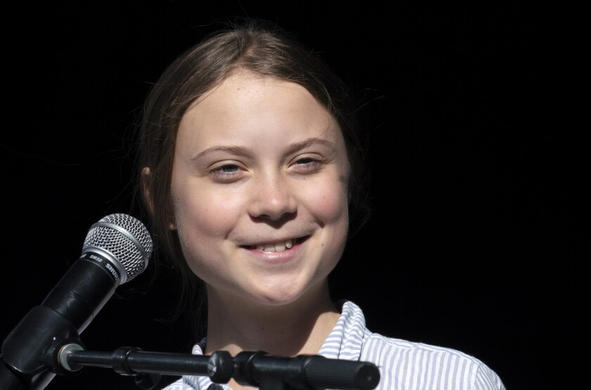 FILE - In this Sept. 27, 2019 file photo, Swedish climate activist and student Greta Thunberg smiles on stage after addressing the Climate Strike in Montreal, Quebec. Thunberg plans to join a climate strike in Denver on Friday, Oct. 11. The event near the state Capitol will include a panel of youth activists and end with a die-in which organizers say will symbolize the millions of people facing danger and death because of climate change. (Paul Chiasson/The Canadian Press via AP, File)