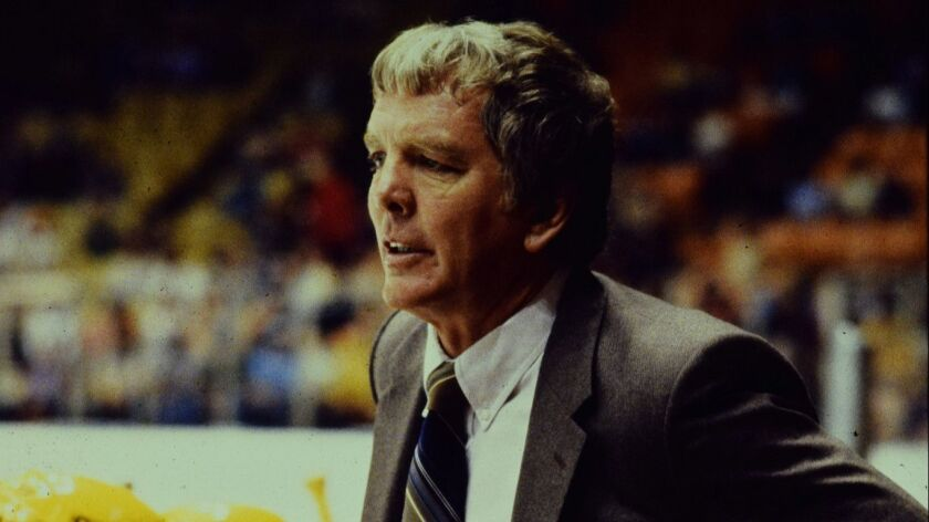 Candid shot of Los Angeles Kings head coach Don Perry behind the bench