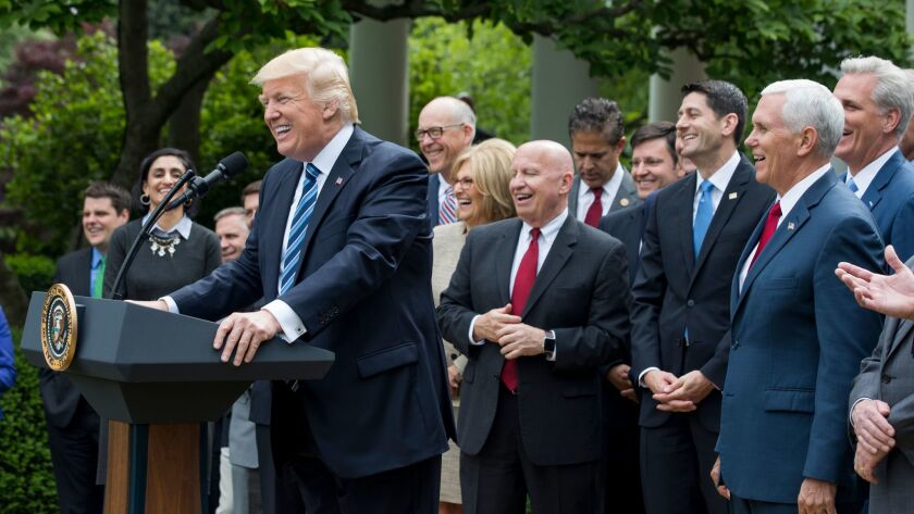 epa05944407 US President Donald J. Trump, along with GOP lawmakers, speaks after the House voted to