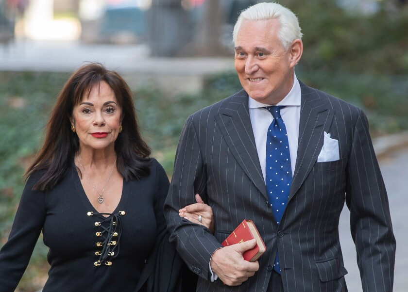Roger Stone with his wife, Nydia, at a federal courthouse in November 2019, a day after his conviction on seven counts.