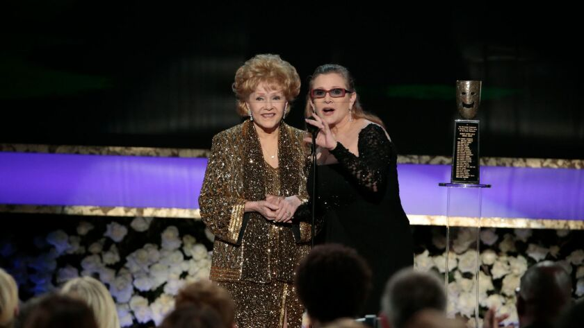 Life Achievement Award recipient Debbie Reynolds with presenter, her daughter Carrie Fisher, at the 21st Screen Actors Guild Awards.