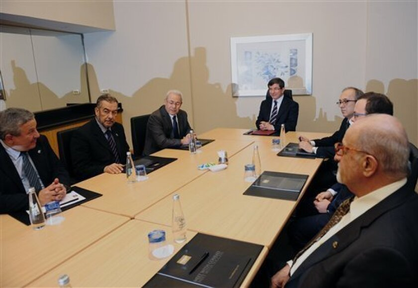 Turkey's Foreign Minister Ahmet Davutoglu, center, meets with the Syrian National Council's Burhan Ghalioun, third left, and other members in Istanbul, Turkey, Friday, March 2, 2012. They are expected to discuss, among other things, opening up a bureau for the newly formed Military Council in Turkey.(AP Photo)