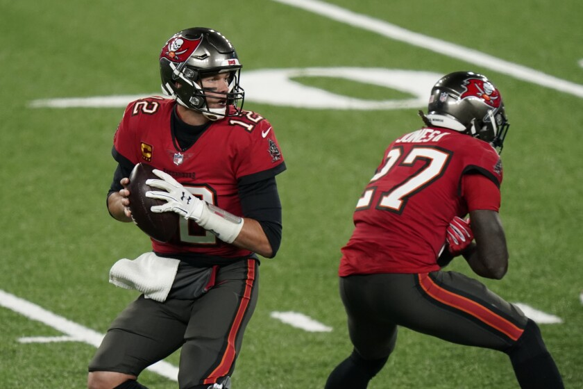 Tampa Bay Buccaneers quarterback Tom Brady looks to throw during the first half against the New York Giants.