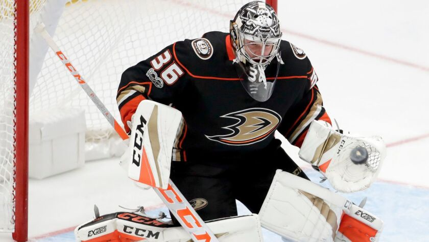 Anaheim Ducks goalie John Gibson blocks a shot as against the Calgary Flames during the third period