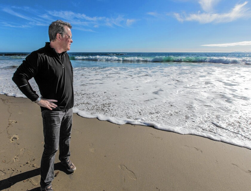 """Laguna Beach artist Todd Kenyon is not offended if you call him the """"wave guy."""" He prides himself on his realistic paintings of waves."""