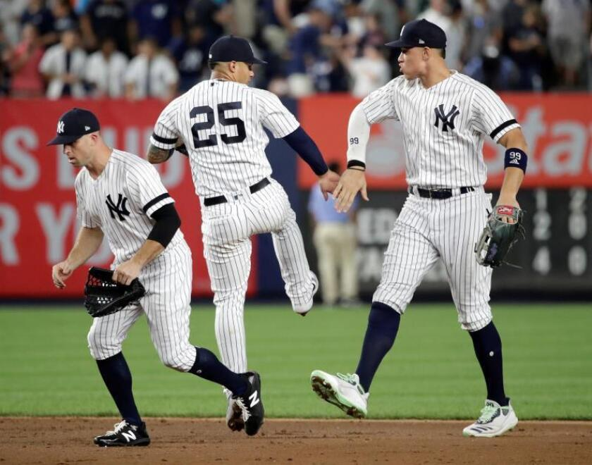 New York Yankees second baseman Gleyber Torres (C) celebrates with teammates New York Yankees center fielder Brett Gardner (L) and New York Yankees right fielder Aaron Judge (R) after the New York Yankees defeated the Boston Red Sox during the MLB game between the Boston Red Sox and the New York Yankees at Yankee Stadium in the Bronx, New York, USA, 02 August 2019. (Estados Unidos, Nueva York) EFE/JASON SZENES