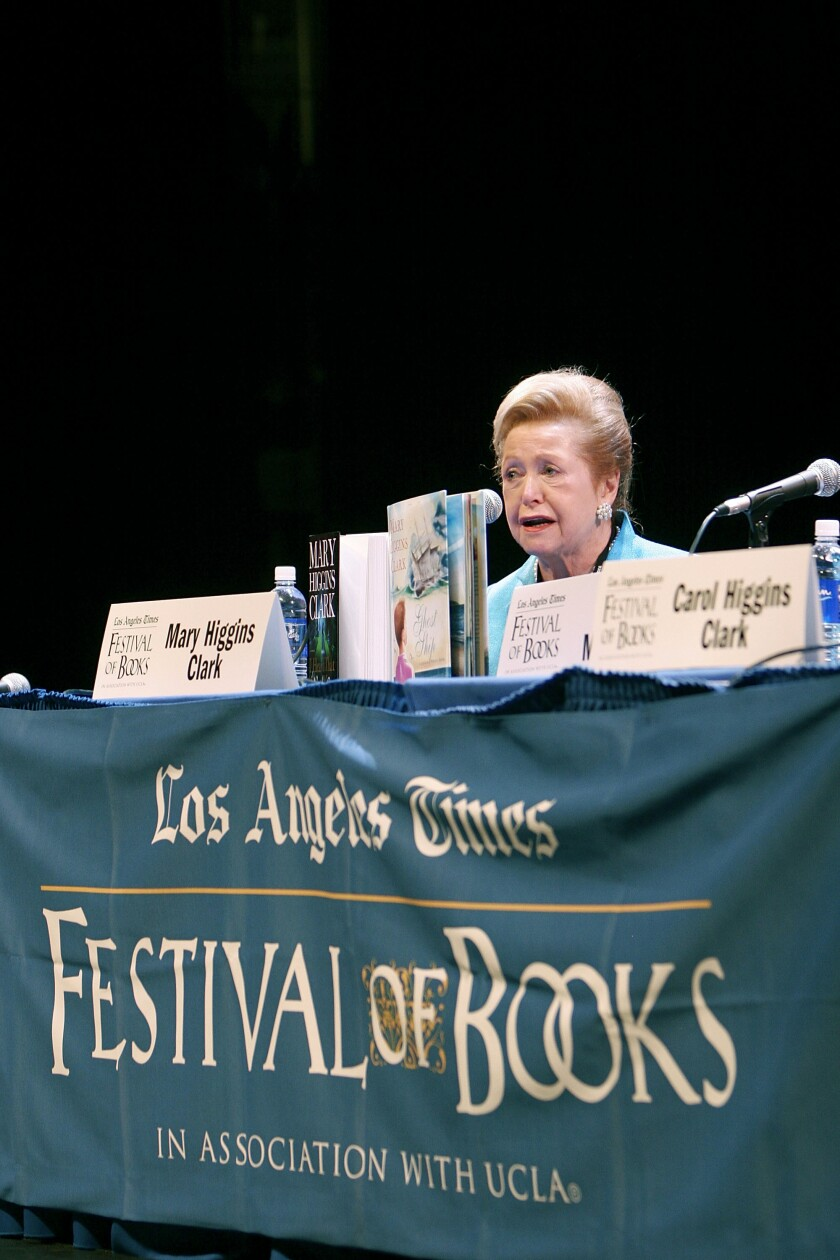 """Mary Higgins Clark at a table draped with a """"Los Angeles Times Festival of Books"""" banner."""