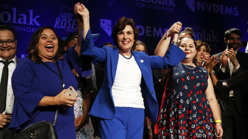 Rep. Jacky Rosen, D-Nev., center, celebrates at a Democratic election night party after wining a Sen
